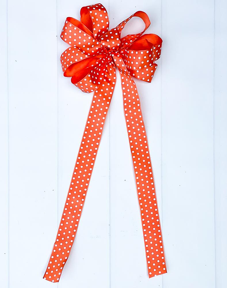 Orange polka dot bow